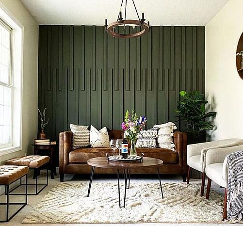 Living room with dark green accent wall