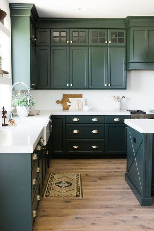 Kitchen with dark green cabinets