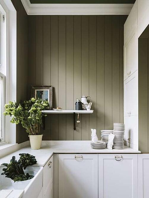 Sage green kitchen walls with white cabinetry