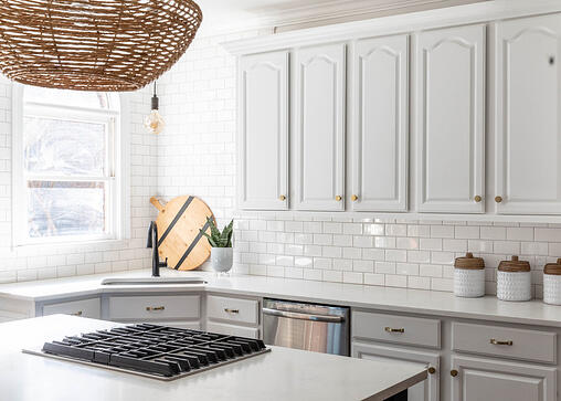 Modern kitchen with white painted cabinets