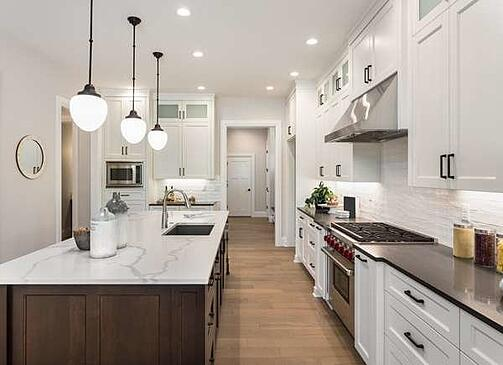 White cabinets with white kitchen walls