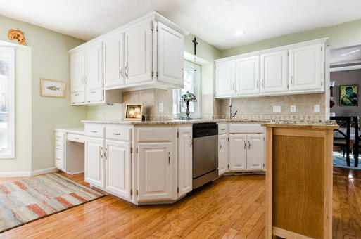 Brush & Roll Painting white kitchen cabinets