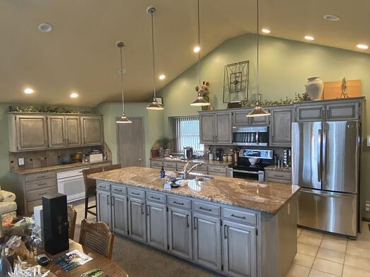 Gray walls with light green cabinets