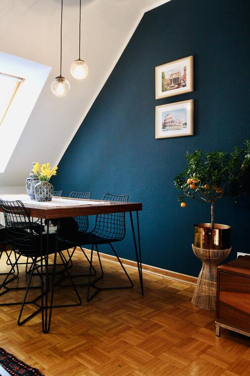 Dining room with dark blue accent wall