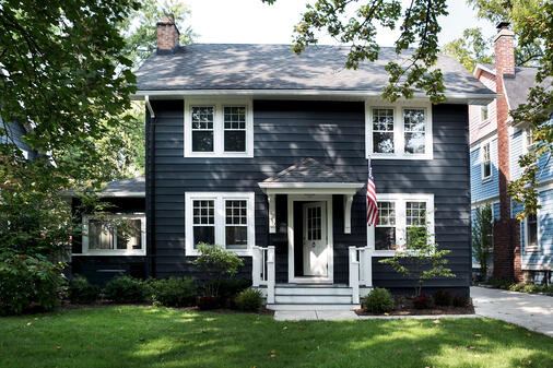Home exterior with black and white paint