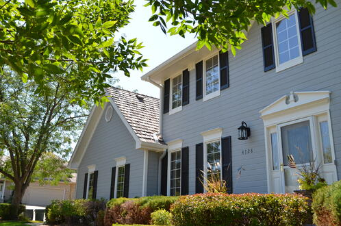 Exterior home with gray and navy paint