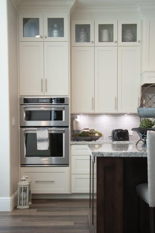 White flat panel slab kitchen cabinets