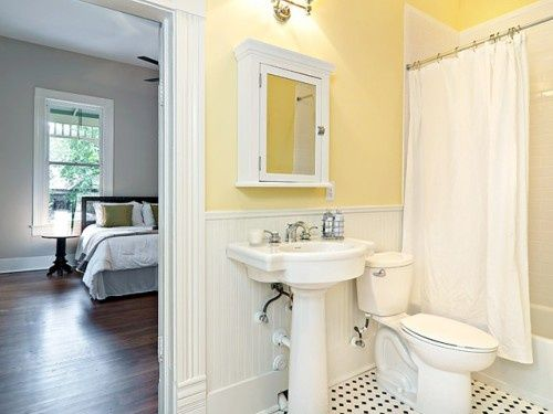 Bathroom with yellow painted walls.