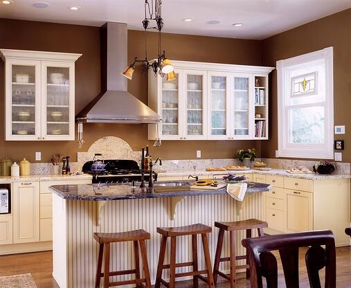 Brown kitchen walls with white cabinets