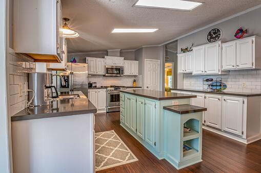 Gray walls with white kitchen cabinets
