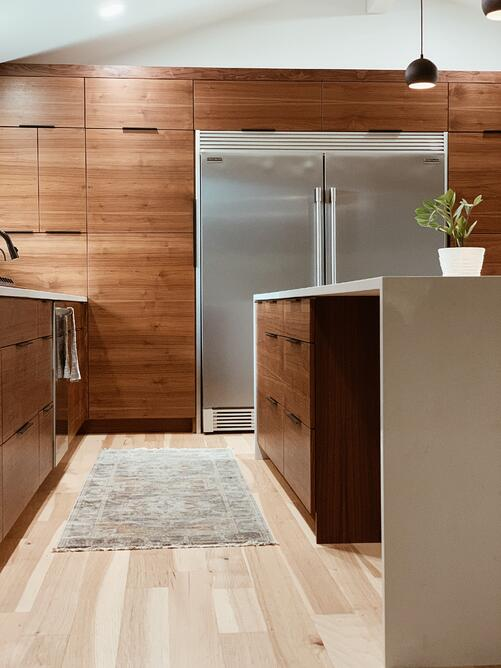 Contemporary kitchen cabinets finished in oak